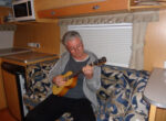 Ukulele playing grey nomad