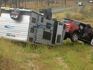 Caravan rollover on the Bruce Highway