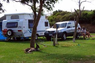 Grey nomads outside their caravan
