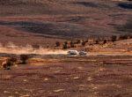 Grey nomad caravan in dust