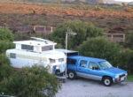 Grey nomad characters f the road travel in pop-top caravan