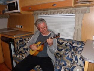 Ukulele playing grey nomad