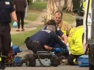 Boy struck by car towing a caravan