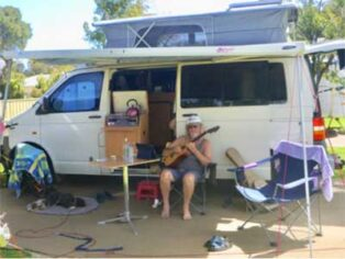 guitar playing grey nomad