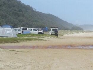 Grey nomads camping at Teewah Beach