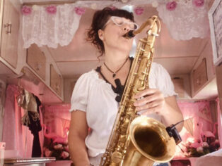 Saxophone playing grey nomad